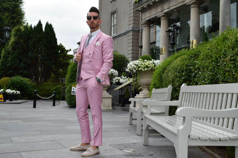 Posing in a pink suit