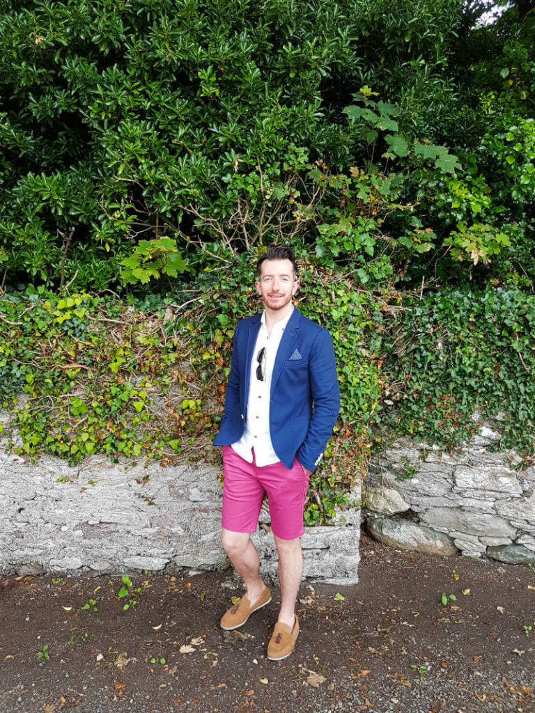 Summer style red shorts and blue blazer