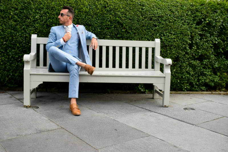 Summer suit relaxing on a park bench