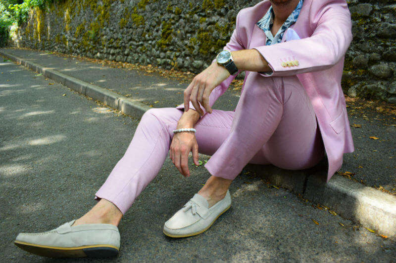 Grey loafers and pink suit